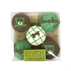 "Luck of the Irish Mini Cupcake Box Our mini cupcakes are shelf stable for 1 year like the rest of our treat line. They are densely chewy in texture (like a day old brownie and biscotti combo) and made with our dog favorite peanut butter apple cake. They are perfect for dogs of all sizes.  Mini Cupcake Size: 1.75"" Clear Box Size: 4"" x 4"" (contains 5 mini cupcakes)  Ingredients: organic oat flour, applesauce, molasses, honey, peanut butter, peanut oil, baking soda, vanilla extract, ginger and cinnamon. Topped with yogurt coating, vegetable coloring and carob.  Guaranteed Analysis: crude protein (min.) 6%, crude fat (min.) 13%, crude fiber (max.) 6%, moisture (max.) 19%."