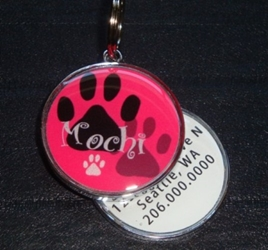 Personalized Pet ID Tag - Pawprint in Pink wooflink, susan lanci, dog clothes, small dog clothes, urban pup, pooch outfitters, dogo, hip doggie, doggie design, small dog dress, pet clotes, dog boutique. pet boutique, bloomingtails dog boutique, dog raincoat, dog rain coat, pet raincoat, dog shampoo, pet shampoo, dog bathrobe, pet bathrobe, dog carrier, small dog carrier, doggie couture, pet couture, dog football, dog toys, pet toys, dog clothes sale, pet clothes sale, shop local, pet store, dog store, dog chews, pet chews, worthy dog, dog bandana, pet bandana, dog halloween, pet halloween, dog holiday, pet holiday, dog teepee, custom dog clothes, pet pjs, dog pjs, pet pajamas, dog pajamas,dog sweater, pet sweater, dog hat, fabdog, fab dog, dog puffer coat, dog winter jacket, dog col