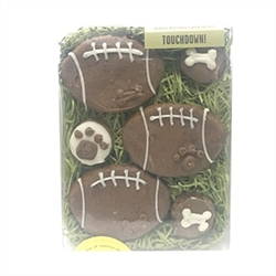 "Touchdown  Dog Treats    These peanut butter treats make a perfect fall box. Go football season!  Box Size: 4.75"" x 5.75"" (contains 6 treats)  Ingredients: organic oat flour, organic brown rice flour, all natural peanut butter, cage-free eggs, carob, wildflower honey and organic cinnamon. Topped with yogurt coating and carob. Guaranteed analysis: crude protein (min.) 14%, crude fat (min.) 15%, crude fiber (max.) 7%, moisture (max.) 5%"